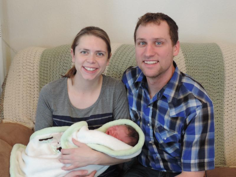 Steva and Brian with newborn Ivan